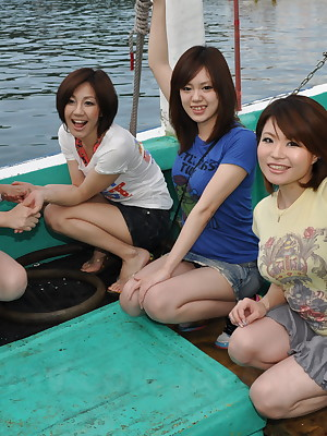 Definitely hot Japanese girls surpassing a motor vehicle speedboat